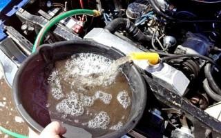 Промыть систему охлаждения двигателя от масла